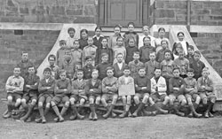 Burra Primary School children, Grade VI, 1920, taken on the front steps of the main building.